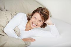 joyful woman relaxing in bed - stock photo
