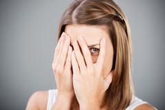 covering face - stock photo