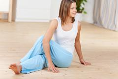 Young female doing yoga at home Stock Photos
