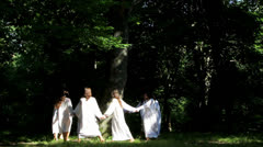 Young girls playing in the forest Stock Footage