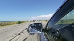 Driving car along the beach Stock Footage