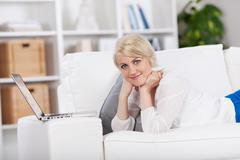 Relaxed woman browsing in internet Stock Photos
