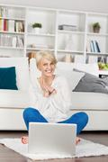 woman looking at laptop and having fun - stock photo