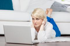 female student working with laptop at home - stock photo