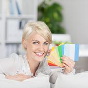 Happy woman showing samples of wall color Stock Photos