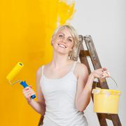 Happy woman with paint tools Stock Photos