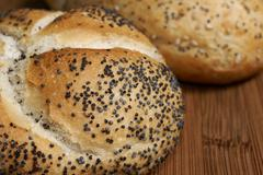 Poppy seed Vienna or Kaiser rolls - stock photo