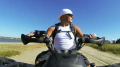 Onboard Camera: Man driving ATV on the beach Stock Footage