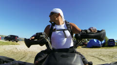 Man driving quadbike on the beach - stock footage