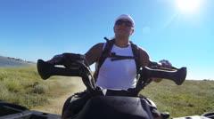 Tourist riding quad bike Stock Footage