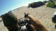 Woman riding quad bike on the beach Stock Footage