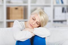 beautiful young woman with closed eyes - stock photo