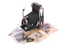 Vintage photography camera with old photos Stock Photos