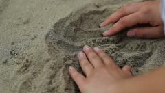 Finding a Coin in Sand Stock Footage