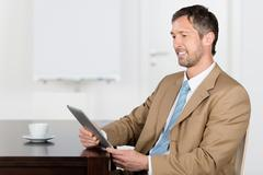 Businessman using digital tablet Stock Photos