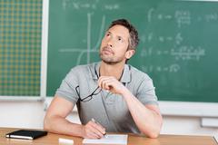 Thinking teacher in classroom Stock Photos