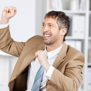 businessman with celebrating victory - stock photo