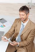 businessman with digital tablet at desk - stock photo