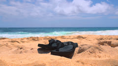 Flip flop on sand Stock Footage