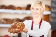 waitress giving sweet bread in cafe - stock photo