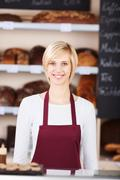 young saleswoman working in bakery - stock photo