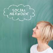 Smiling student thinking of social network Stock Photos
