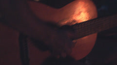Guitar by the campfire Stock Footage