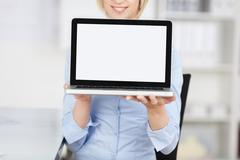 woman displaying laptop - stock photo
