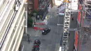 Stock Video Footage of View of scaffolding with road and pedestrians beneath