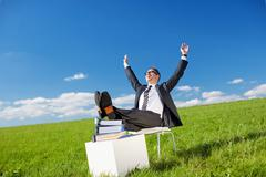 Businessman relaxing in the fresh air Stock Photos