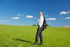 Businessman in meadow Stock Photos