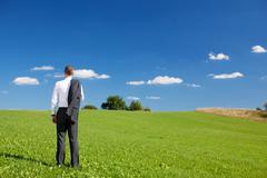 Stock Photo of manager standing under a blue sky