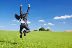 Stock Photo of businessman jumping for joy