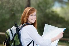 young woman backpacking in nature - stock photo