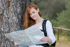 woman backpacker with a map - stock photo