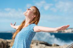 beautiful woman celebrating the sunshine - stock photo