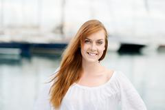 pretty young woman at the harbour - stock photo