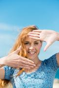 Stock Photo of woman making a finger frame