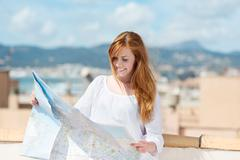 woman with a route map - stock photo