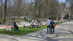 BRUSSELS, BELGIUM: People enjoying sunny day at Parc de Bruxelles Stock Footage