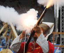 shooting a musket - stock photo