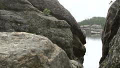 Rocks in mountain pan to lake Stock Footage