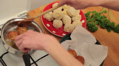 Extracting meatballs from fryer Stock Footage