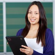 Modern student using digital pad in class room Stock Photos