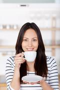 Modern woman drinking a cup of coffee Stock Photos