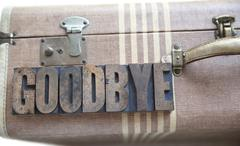 Goodbye word on vintage suitcase Stock Photos