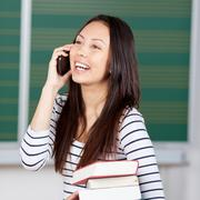 young woman using smartphone at university - stock photo