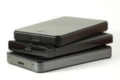 Pile of external usd hard drive Stock Photos