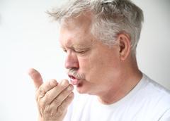man sneezes - stock photo