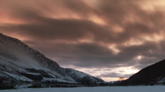 Dramatic Time lapse shot of valley in the snow - stock footage